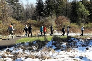 Photograph of hikers on the new Universal Access Trail in Bloomfield's LaSalette Open Space