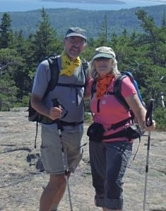 Photograph of Kevin Gough and Paula Jones hiking on a mountain