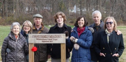 Photograph of Marguerite Evans, her daughter Dayle and husband Mike Williams, her son Donald Evans Jr. and wife Patricia, his daughter Deborah Quigley, and grandson Kaie Quigley
